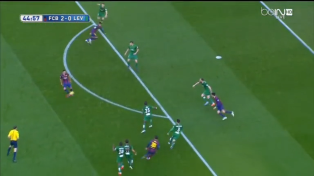 A combination that ends with a 1-2 between Messi and Xavi. Note the amount of defenders Messi's draws out of position before Xavi chips the ball through.
